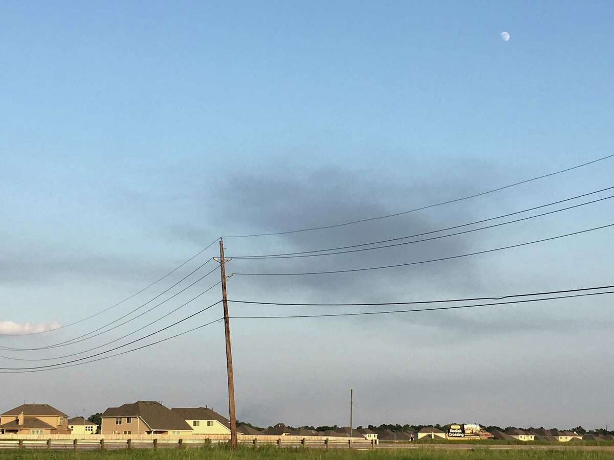 Smoke lingers over Crosby, TX after an earlier fire at the Arkema chemical facility Friday, Sept. 1, 2017.