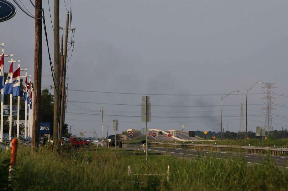 Smoke lingers over the Arkema plant after another fire at the facility Friday, Sept. 1, 2017. Photo: Mark Mulligan, Mark Mulligan / Houston Chronicle / 2017