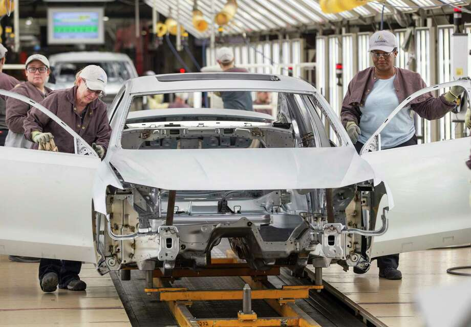 Workers produce vehicles at Volkswagen's lone U.S. plant in Chattanooga, Tenn. Volkswagen makes the Passat sedan at the plant and is ramping up production of the new seven-seat Atlas SUV. Photo: Erik Schelzig, STF / Copyright 2017 The Associated Press. All rights reserved.