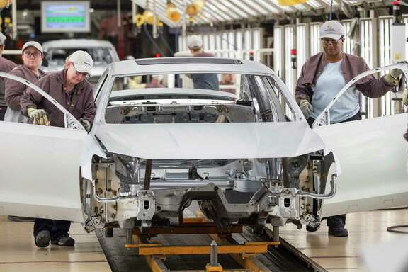 Workers produce vehicles at Volkswagen's lone U.S. plant in Chattanooga, Tenn. Volkswagen makes the Passat sedan at the plant and is ramping up production of the new seven-seat Atlas SUV.
