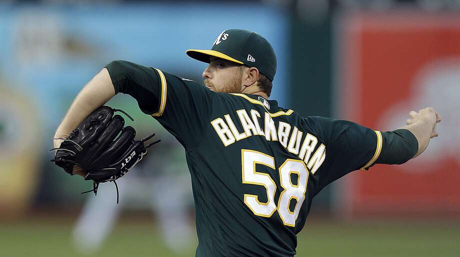 Oakland Athletics pitcher Paul Blackburn works against the Baltimore Orioles during the first inning of a baseball game Friday, Aug. 11, 2017, in Oakland, Calif. (AP Photo/Ben Margot) Photo: Ben Margot, Associated Press