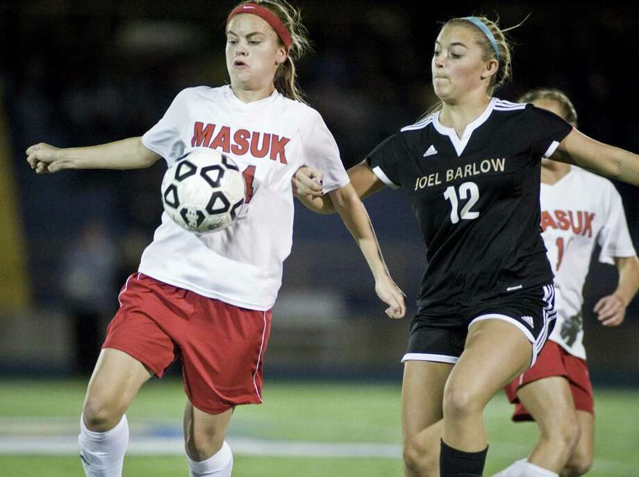 Masuk High School's Kacey Lawrence and Joel Barlow High School's McKenzie Perna converge on the ball during the SWC girls soccer final played at Newtown High School. Thursday, Nov. 3, 2016 Photo: Scott Mullin / For Hearst Connecticut Media / The News-Times Freelance