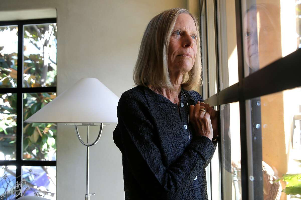 Alice Rodgers in her South Park home in San Francisco, Ca., on Tues. August 29, 2017. Rodgers a South Park resident is in a constant battle to keep the area of her shared courtyard and her balcony clean, with all the nearby commute traffic leaving behind soot.