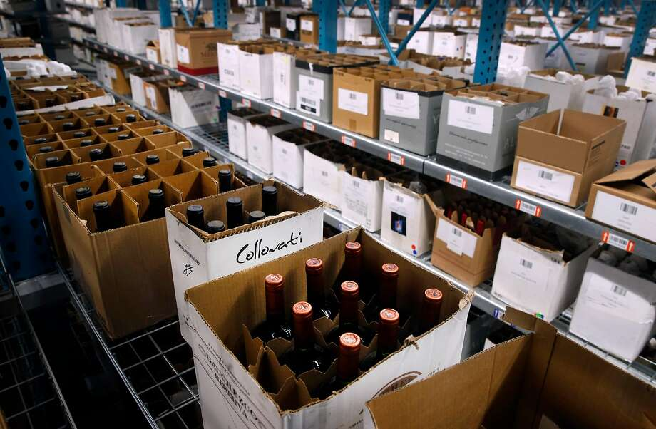 Cases of wine from Northern California wineries are stocked on shelves at the WineDirect warehouse in American Canyon. Photo: Paul Chinn, The Chronicle