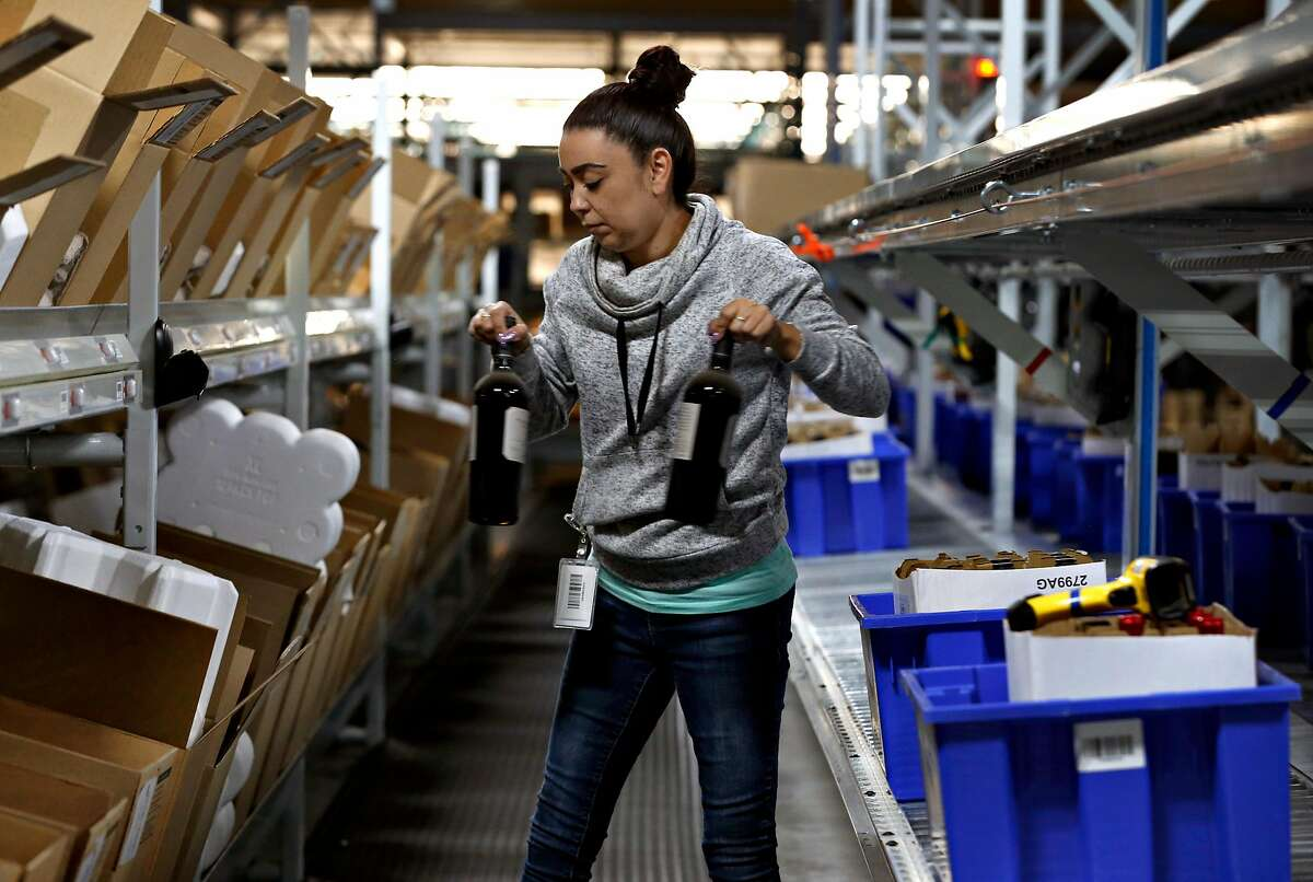 Veresa Anderson completes a customer's order at the Wine Direct fulfillment and distribution center in American Canyon, Calif. on Tuesday, Aug. 29, 2017.