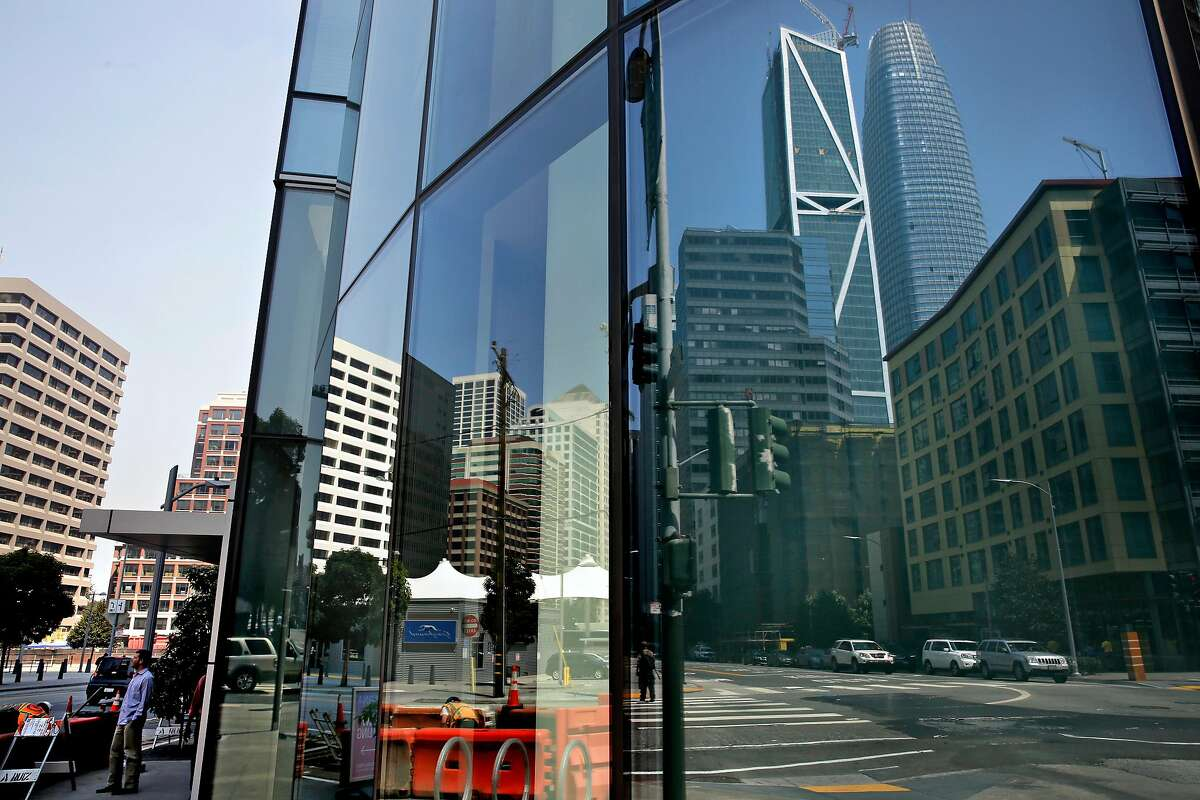 Salesforce Tower is reflected in the windows of the Lumina Towers along Folsom between Beale and Main streets in downtown San Francisco, Ca. on Fri. September 1, 2017.