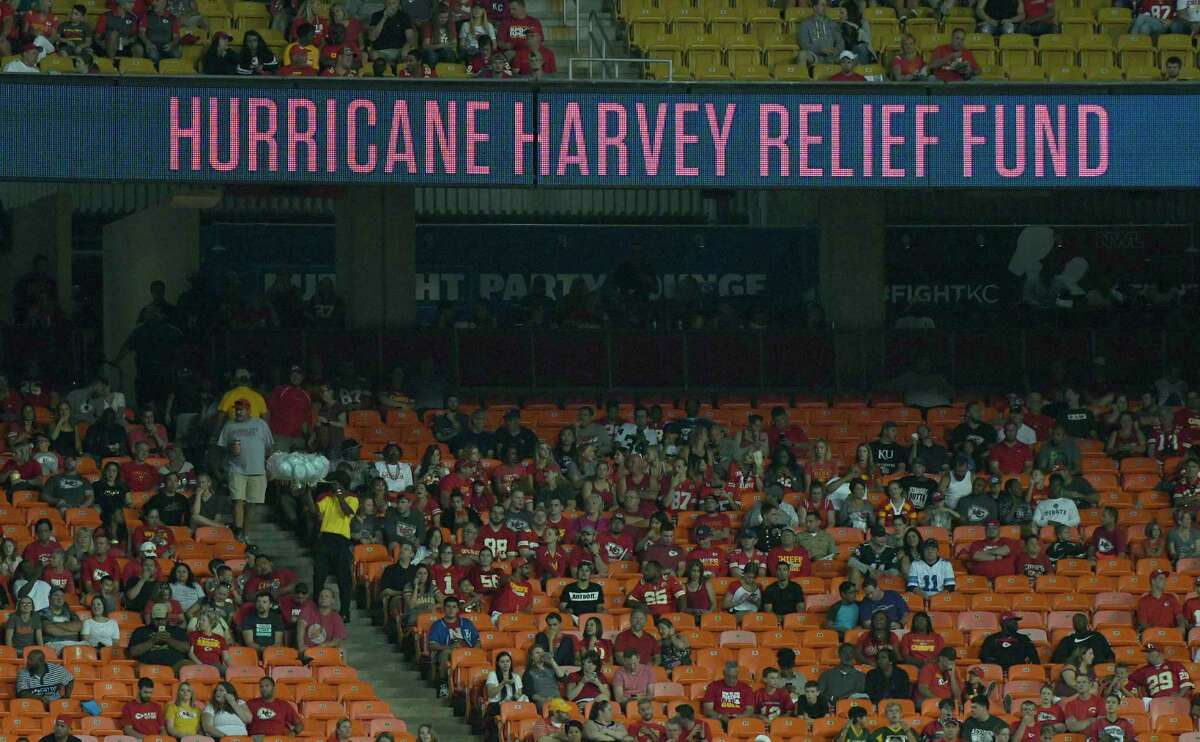 The billboard at Arrowhead Stadium calls for donations to the Hurricane Harvey relief fund during an NFL preseason football game Thursday between the Tennessee Titans and the Kansas City Chiefs in Kansas City, Mo. (AP Photo/Ed Zurga)