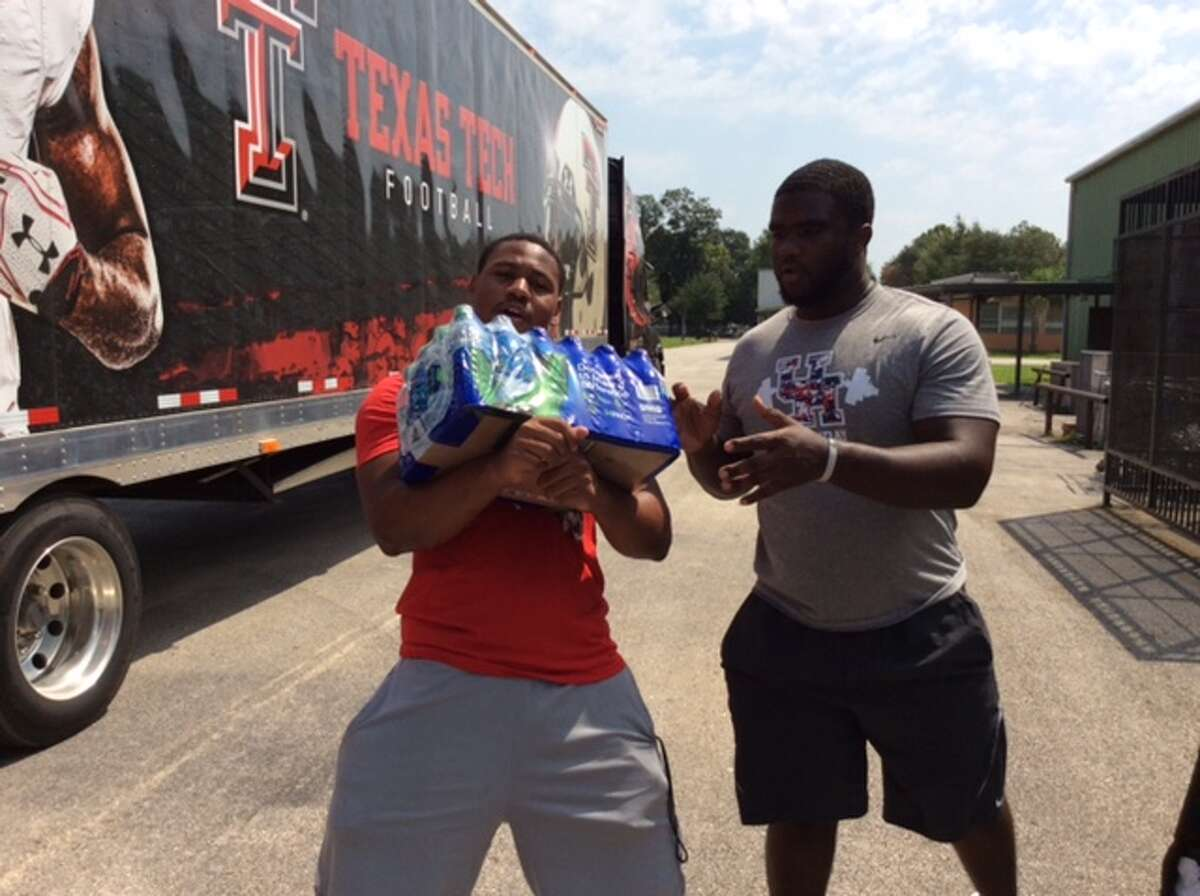 University of Houston players assist with Hurricane Harvey relief efforts.