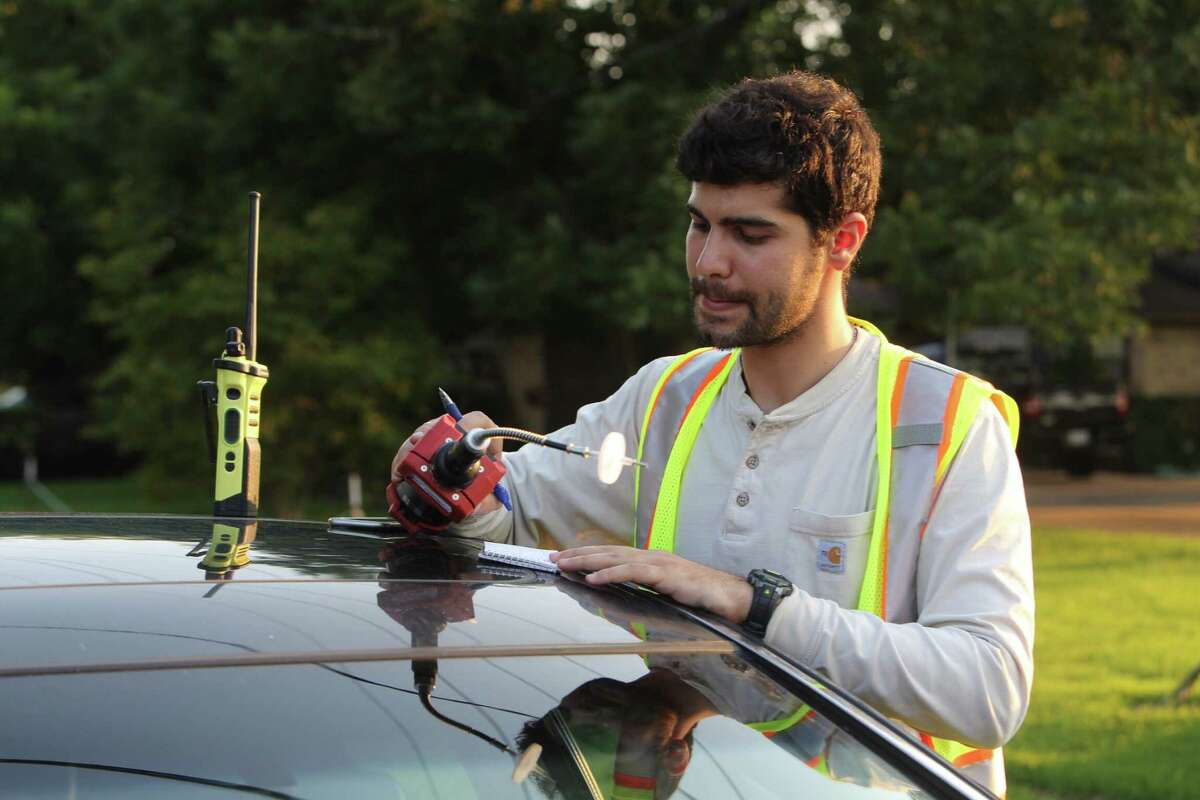 A consultant uses an air-monitoring device near the Arkema chemical facility in Crosby.
