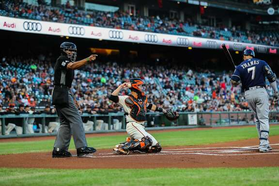 Umpire CB Bucknor (54) (left) calls a strike during a game between the San Francisco Giants and the Milwaukee Brewers at AT&T Park in San Francisco, Calif., on Tuesday, Aug. 22, 2017.