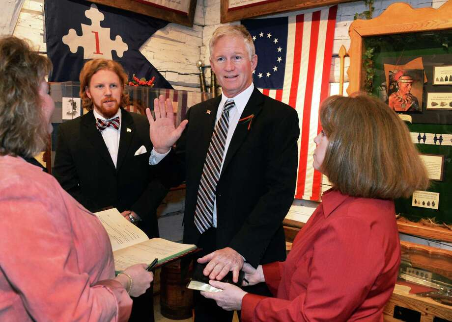 Stillwater village mayor elect Rick Nelson, center, takes the oath of office from Village Cleark/Treasurer Sheristin Tedesco, left, with son Patrick and wife Catherine, right, at Stillwater Blockhouse Park Saturday April 4, 2015 in Stillwater, NY.  (John Carl D'Annibale / Times Union) Photo: John Carl D'Annibale / 00031293A