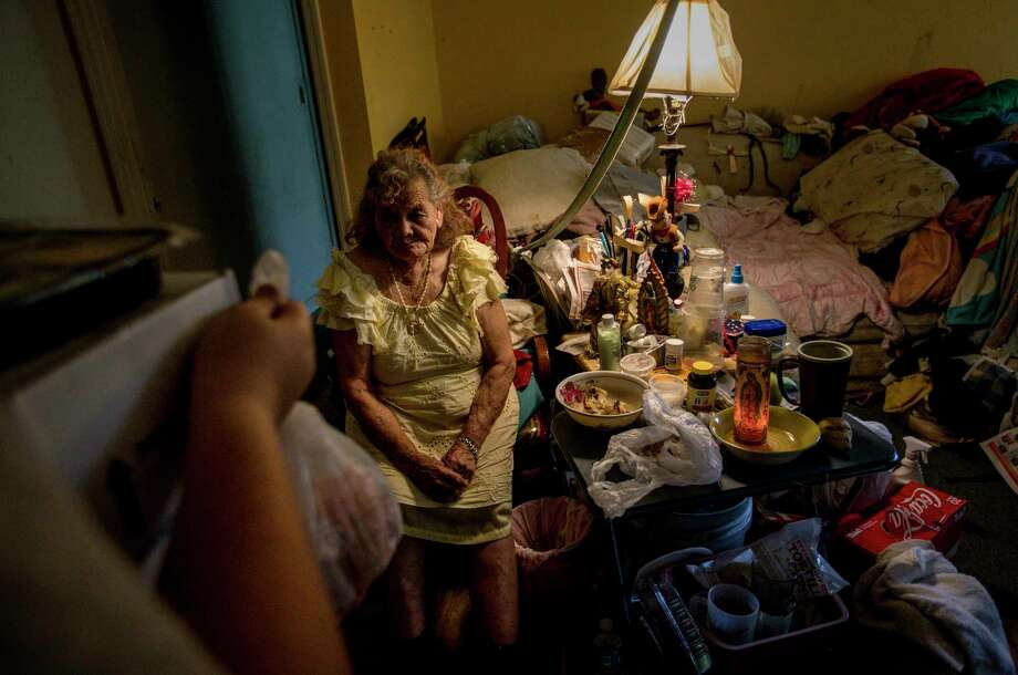 Pabla Cruz, 88, welcomes a food delivery on Friday by Meals on Wheels, the first since Hurricane Harvey struck last week. Cruz and her daughter rode out Harvey by eating tortillas they soaked in water to make them last longer. Story on page A6. Photo: Jon Shapley, Houston Chronicle / © 2017 Houston Chronicle