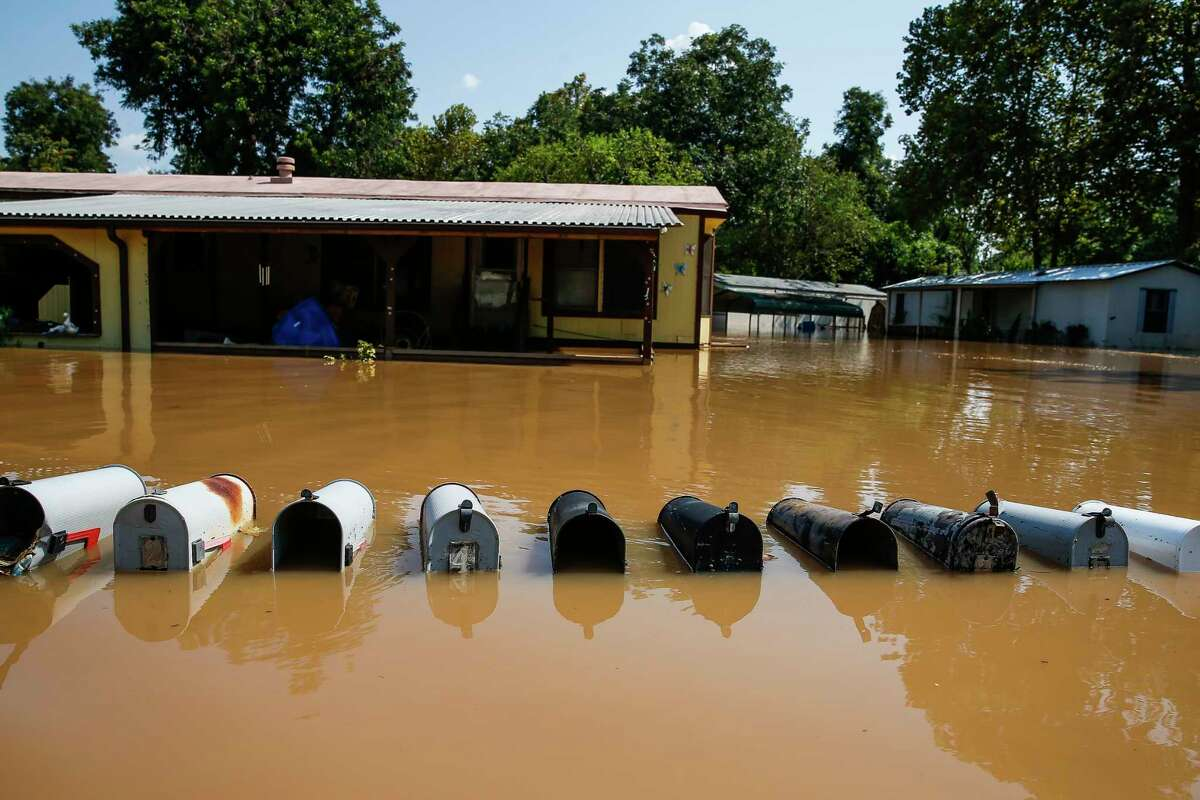 Mailboxes are inundated by Brazos River flooding in Richmond after Hurricane Harvey.