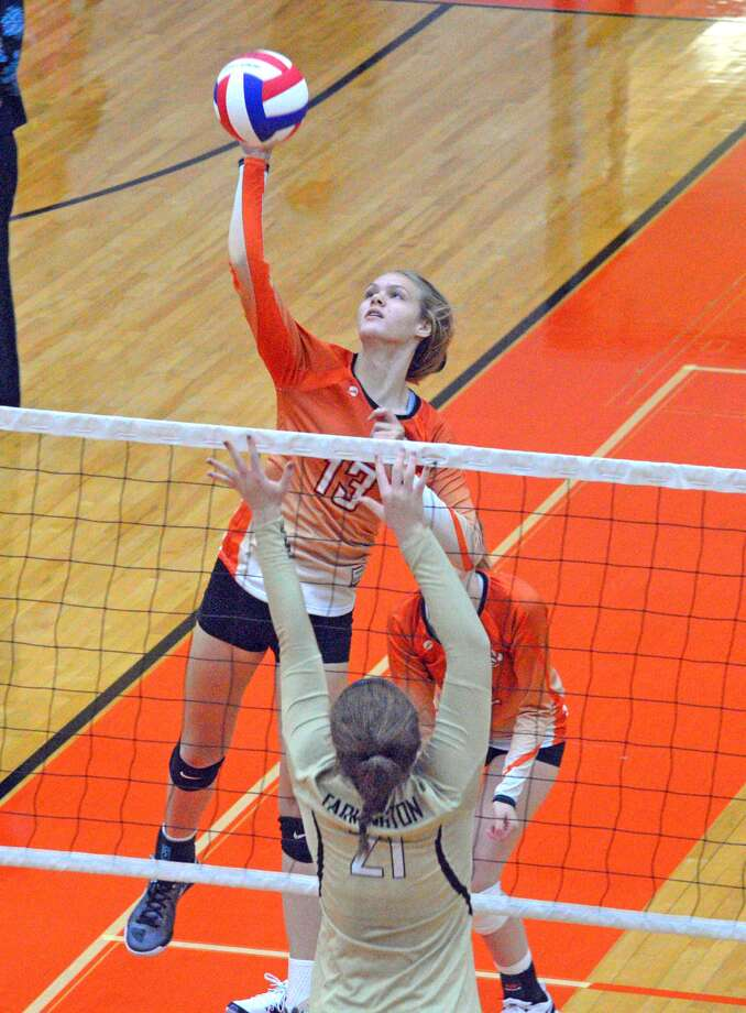 Edwardsville freshman Storm Suhre goes up for a kill during Friday's second pool play match against Farmington.