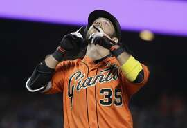 San Francisco Giants' Brandon Crawford points skyward as he reaches home plate on a two-run home run against the St. Louis Cardinals during the second inning of a baseball game Friday, Sept. 1, 2017, in San Francisco. (AP Photo/Marcio Jose Sanchez)