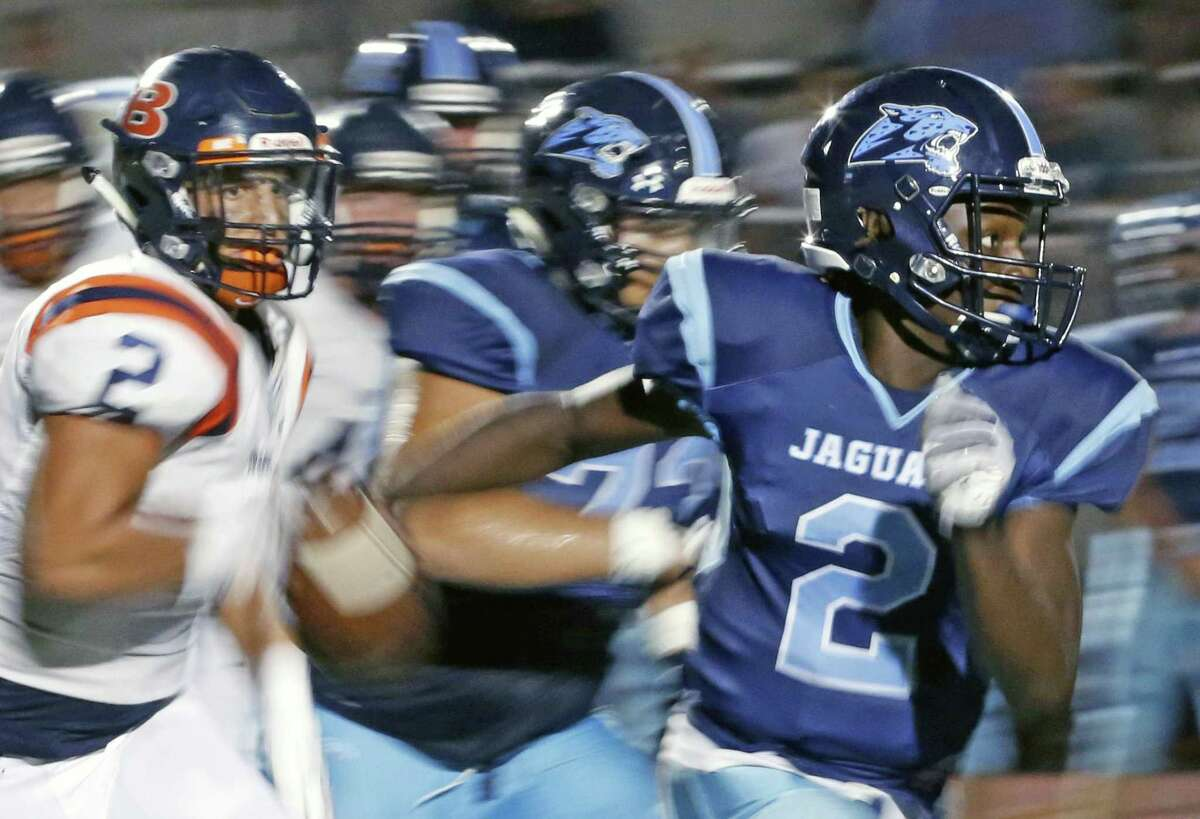 Johnson?•s Mike Chandler scrambles of yardage in season-opening high school football game between Brandeis and Johnson at Heroes Stadium on Friday September 1 ,2017