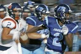 JohnsonÕs Mike Chandler scrambles of yardage in season-opening high school football game between Brandeis and Johnson at Heroes Stadium on Friday September 1 ,2017