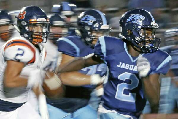 JohnsonÕs Mike Chandler scrambles of yardage in season-opening high school football game between Brandeis and Johnson at Heroes Stadium on Friday September 1 ,2017