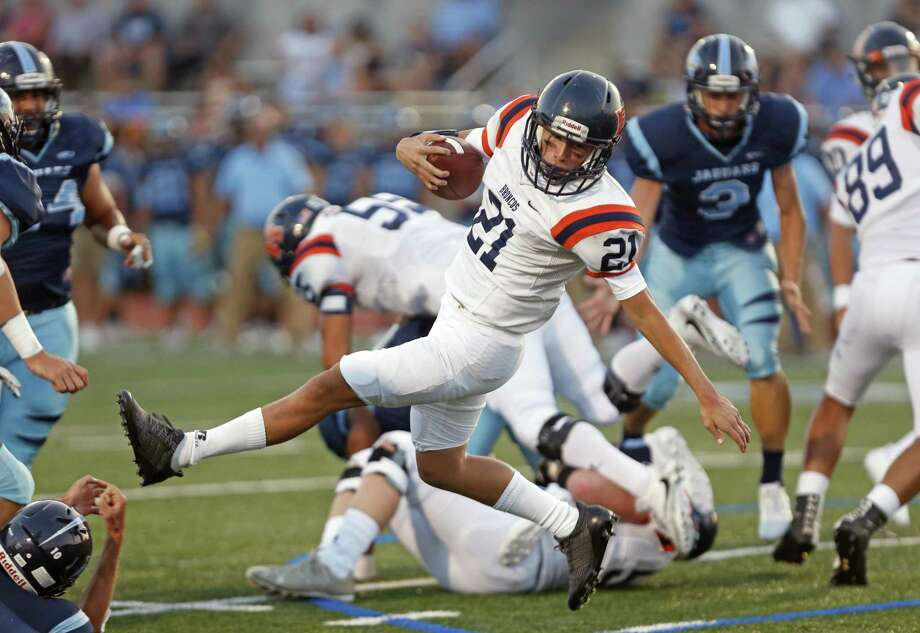 BrandeisÕs J Nova Rangel spins to gain more yardage in season-opening high school football game between Brandeis and Johnson at Heroes Stadium on Friday September 1 ,2017 Photo: Ron Cortes, Freelance / For The San Antonio Express-News