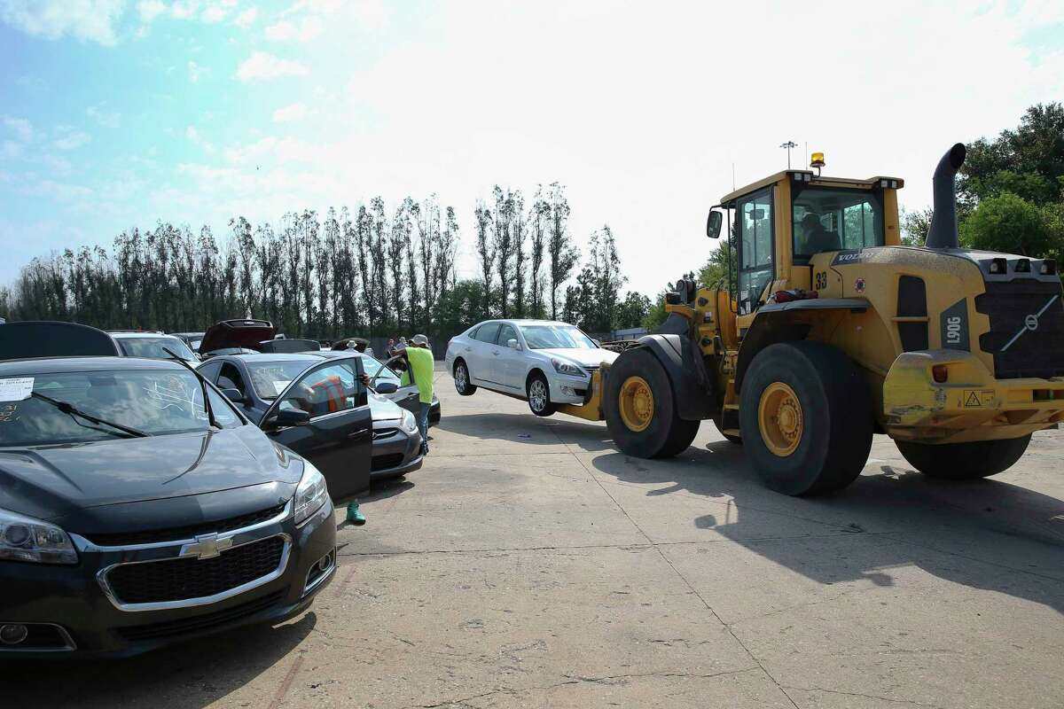 Hurricane Harvey flooded cars are lined up at a salvage yard north of Houston and waiting to be estimated by automotive appraisers from an insurance company Friday, Sept. 1, 2017, in Houston. ( Yi-Chin Lee / Houston Chronicle )