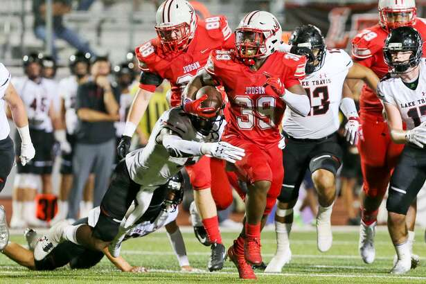 Judson's Rashad Wisdom runs through the Austin Lake Travis defense for a first down during the second half of their season-opening high school football game at Rutledge Stadium on Friday, Sept. 1, 2017.