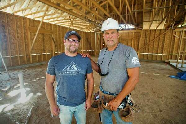 Paul Orvosh (right) and his son Jason, co-owners of Orvosh Builders, pose for a portrait inside the final section of the Orvosh Builders office complex and showroom they are building at 800 S. Poseyville Road in Midland. (Katy Kildee/kkildee@mdn.net)