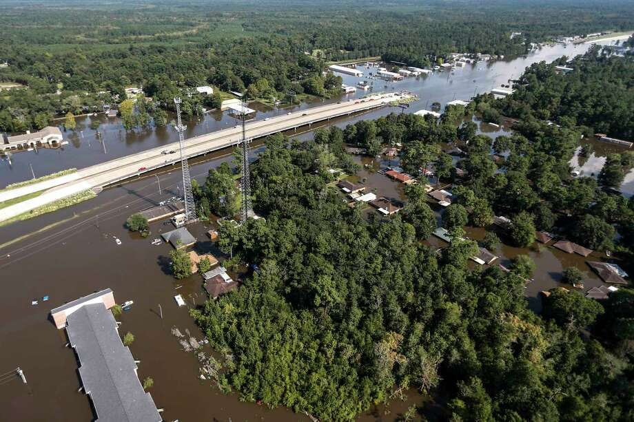 Highway 96 is submerged by floodwaters of Tropical Storm Harvey on Friday, Sept. 1, 2017, in Lumberton. (Brett Coomer/Houston Chronicle via AP) Photo: Brett Coomer, MBO / © 2017 Houston Chronicle