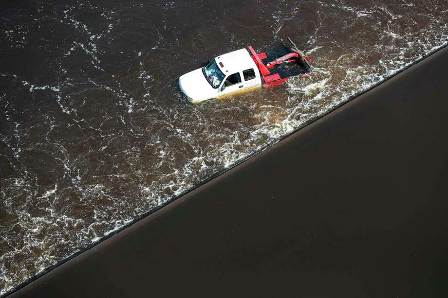 A truck is half submerged along a road in floodwaters from Tropical Storm Harvey on Friday, Sept. 1, 2017, in Lumberton, Texas. (Brett Coomer/Houston Chronicle via AP) Photo: Brett Coomer, MBO / © 2017 Houston Chronicle
