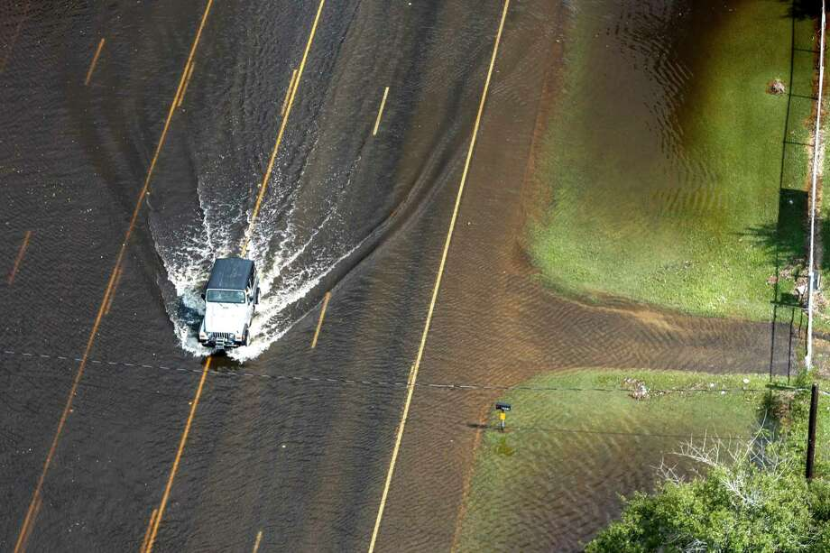 A jeep rolls through floodwaters of Tropical Storm Harvey on Friday, Sept. 1, 2017, near Vidor, Texas. ( Brett Coomer / Houston Chronicle ) Photo: Brett Coomer, Staff / © 2017 Houston Chronicle