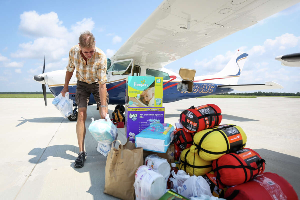 Harper Goodwin, who flew from Arkansas, unloads donations from his Cessna 210 Turbo aircraft during Operation Air Drop on Friday, Sept. 1, 2017, at Conroe-North Houston Regional Airport.
