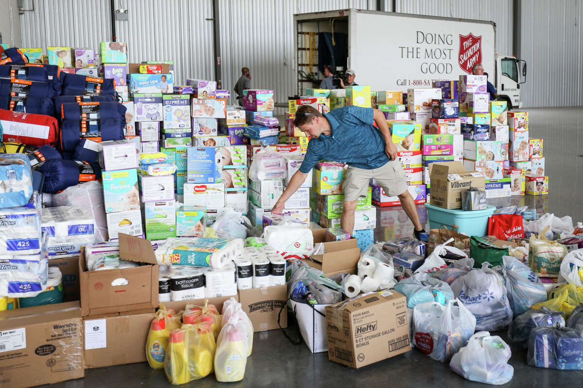 Volunteer Travis Forshee organizes donations as a Salvation Army truck pulls up to begin loading donations during Operation Air Drop on Friday, Sept. 1, 2017, at Conroe-North Houston Regional Airport.