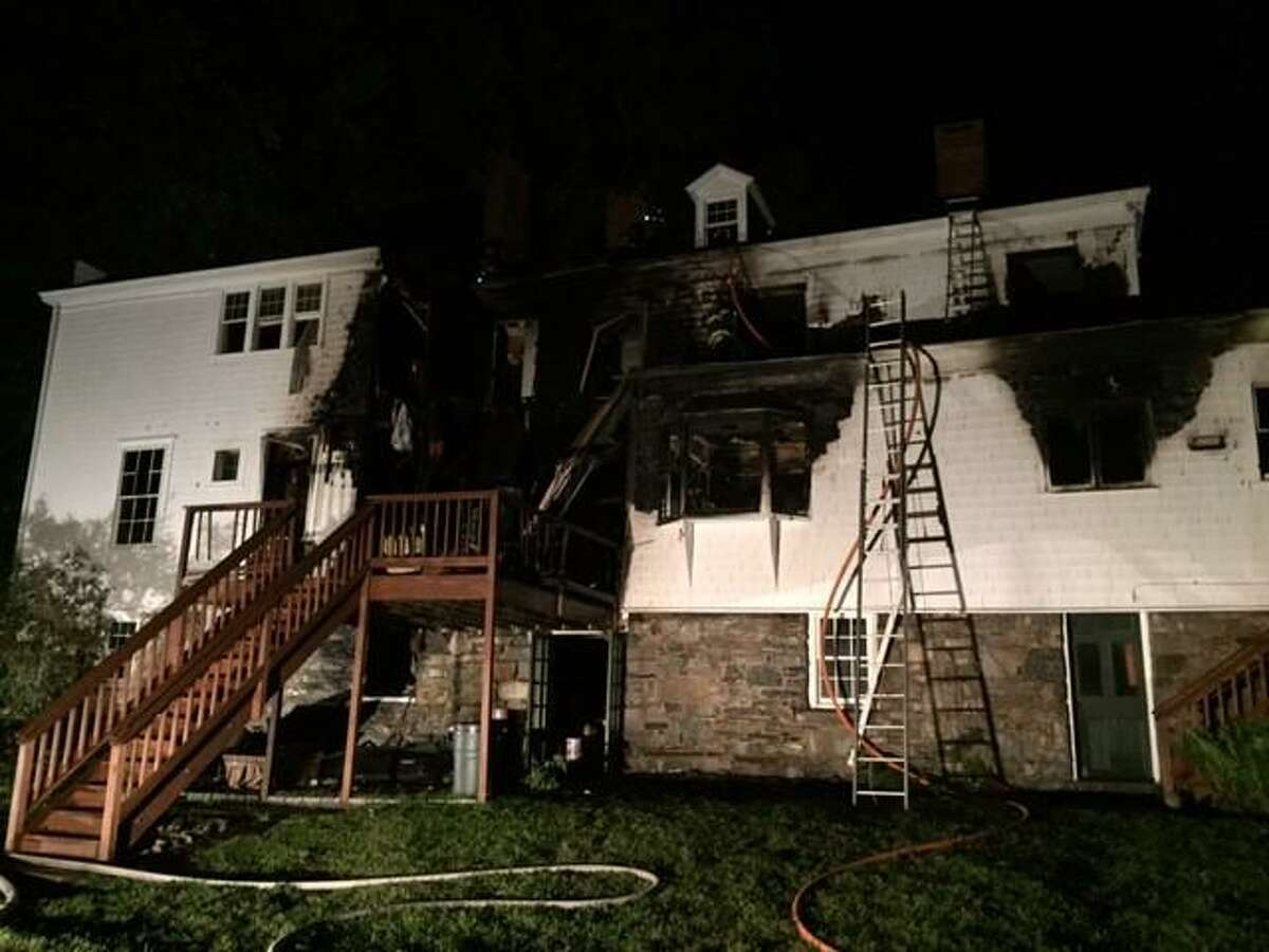 A child was forced to jump from a window early Saturday morning to escape flames that tore through this historic Old Post Road home in Fairfield.