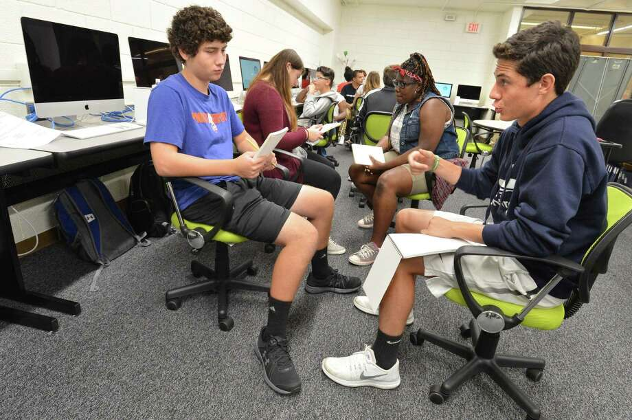 Billy Neschis and Lucas Aravajo join the discussion during the Digital Media Pathways, Advanced Media Studies class in the new Innovation Center at Norwalk High School on Thursday, Aug. 31. Photo: Alex Von Kleydorff / Hearst Connecticut Media / Norwalk Hour
