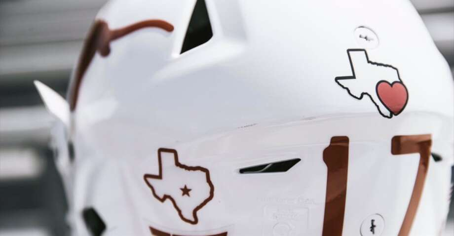 The University of Texas football team is showing support for Houston with a helmet decal today. Photo: Twitter
