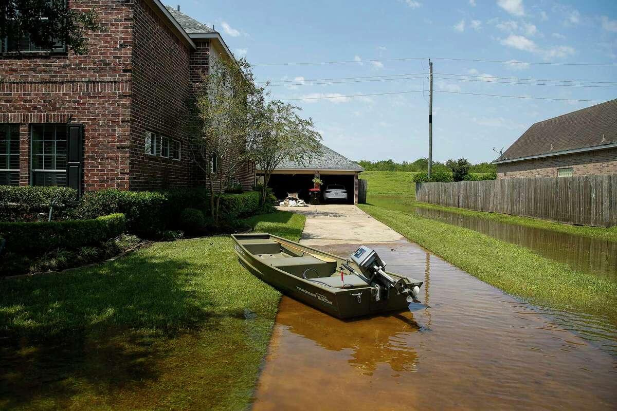 A boat sits in a driveway after Tropical Storm Harvey Friday, Sept. 1, 2017 in Sienna Plantation.