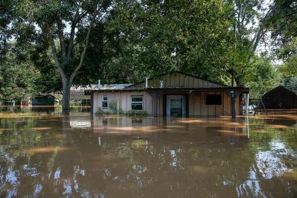 A flooded hose sits in floodwaters from the Brazos River after Tropical Storm Harvey.