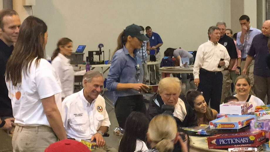 President Trump and Gov. Greg Abbott meet with children displaced by Harvey at the NRG Center. Photo: Jeremy Wallace