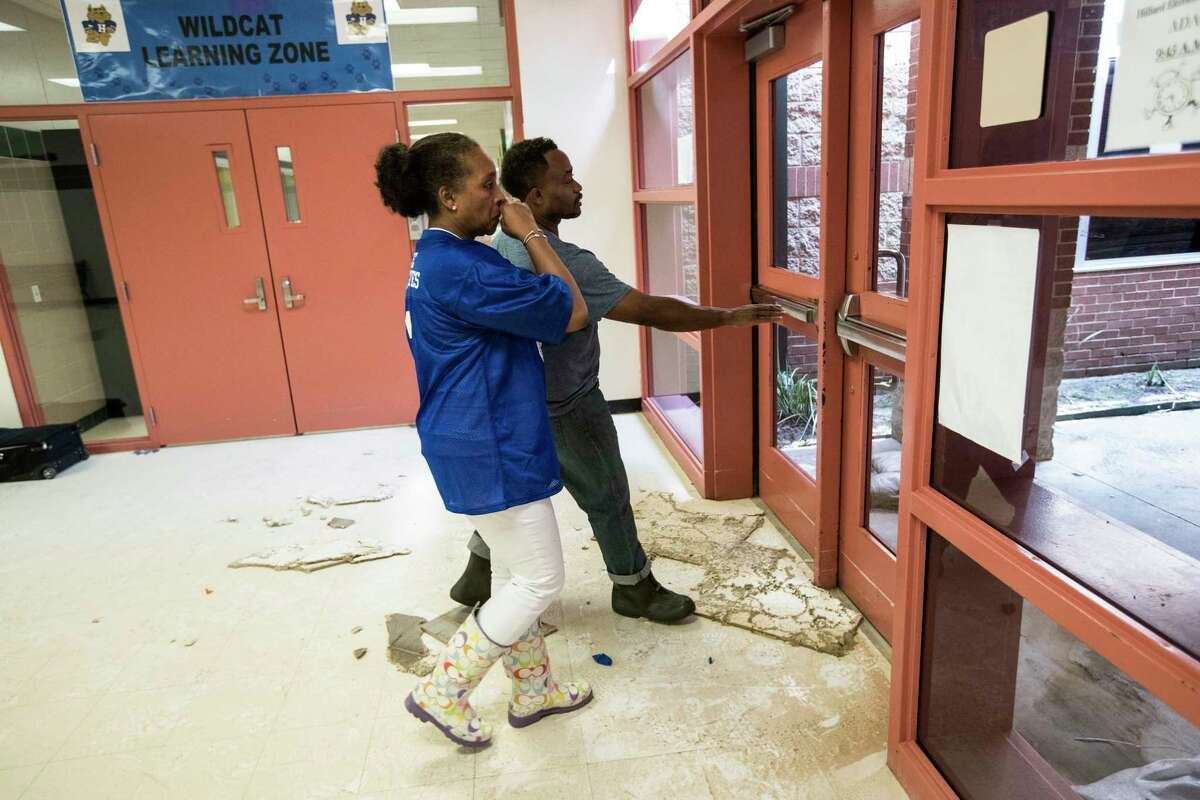 Rhonda Skillern-Jones, Houston Independent School District board trustee, walks out of flood-damaged A.G. Hilliard Elementary School, following a tour of the school in the aftermath of Tropical Storm Harvey, on Saturday, Sept. 2, 2017, in Houston.