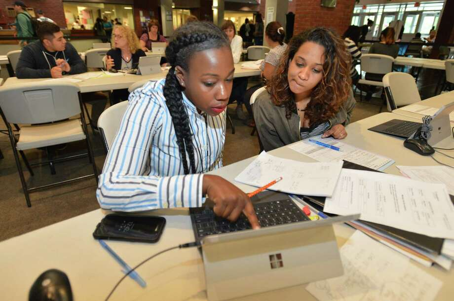 Cheleeza Marajh of Darien schedules her language classes while registering with student success coach Pracilya Titus during the first day of classes at Norwalk Community College on Tuesday, Aug. 29. Photo: Alex Von Kleydorff / Hearst Connecticut Media / Norwalk Hour