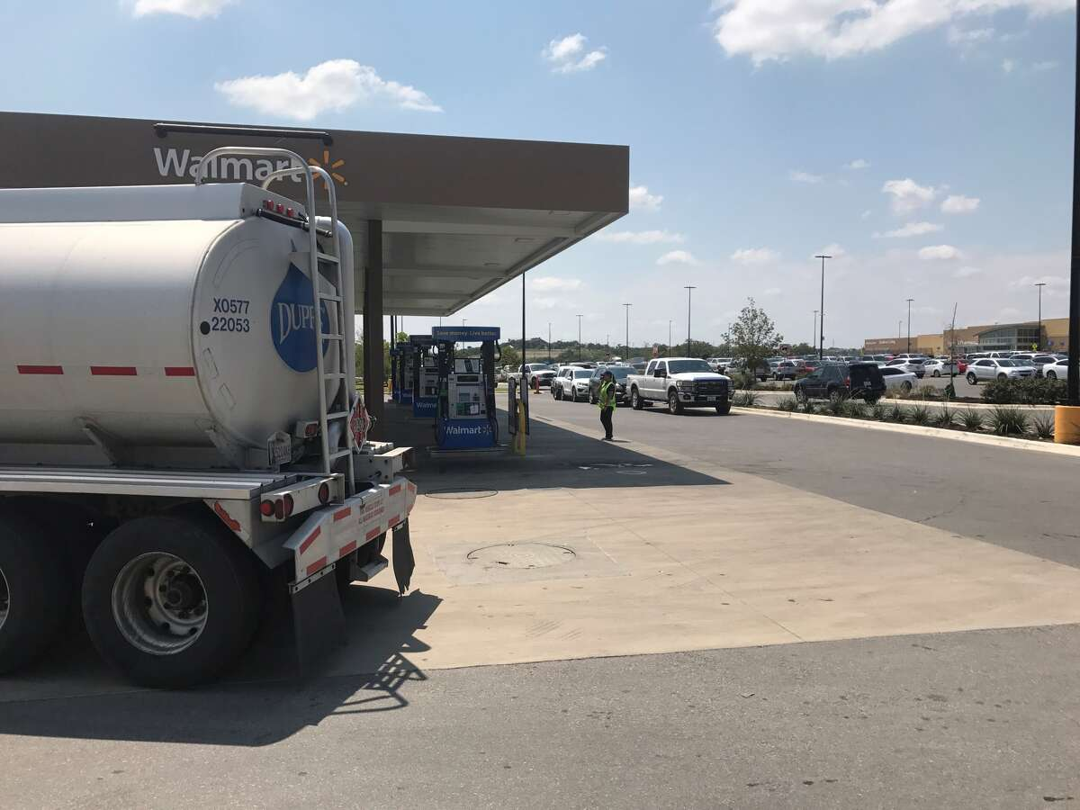 A gas truck delivers fuel to the Walmart at U.S. 281 and Texas 46 in Bulverde as motorists immediately begin lining up just before 1 p.m. Saturday, Sept. 2, 2017.