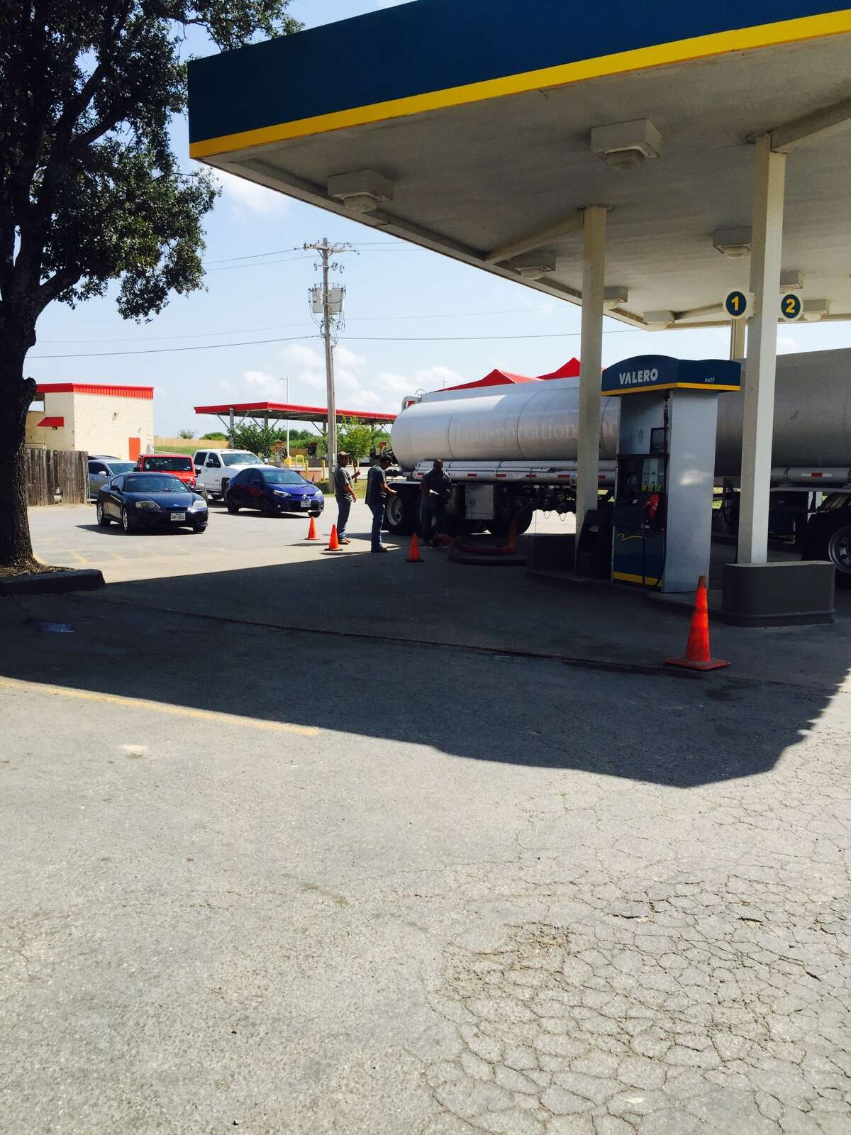 Vehicles line up as a gas truck fills the tanks at the Valley Mart, 521 U.S. 90 East, in Castroville at about 11:30 a.m., Saturday, Sept. 2, 2017.