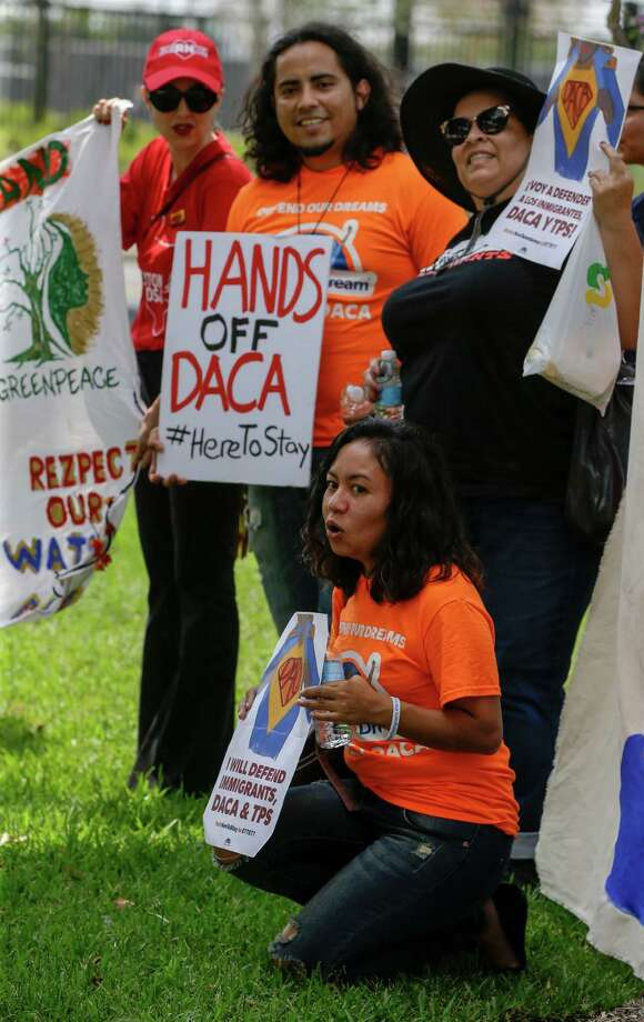 Protesters from DACA and environmental groups rally at NRG during President Trump's visit. Photo: Melissa Phillip / Houston Chronicle 2017