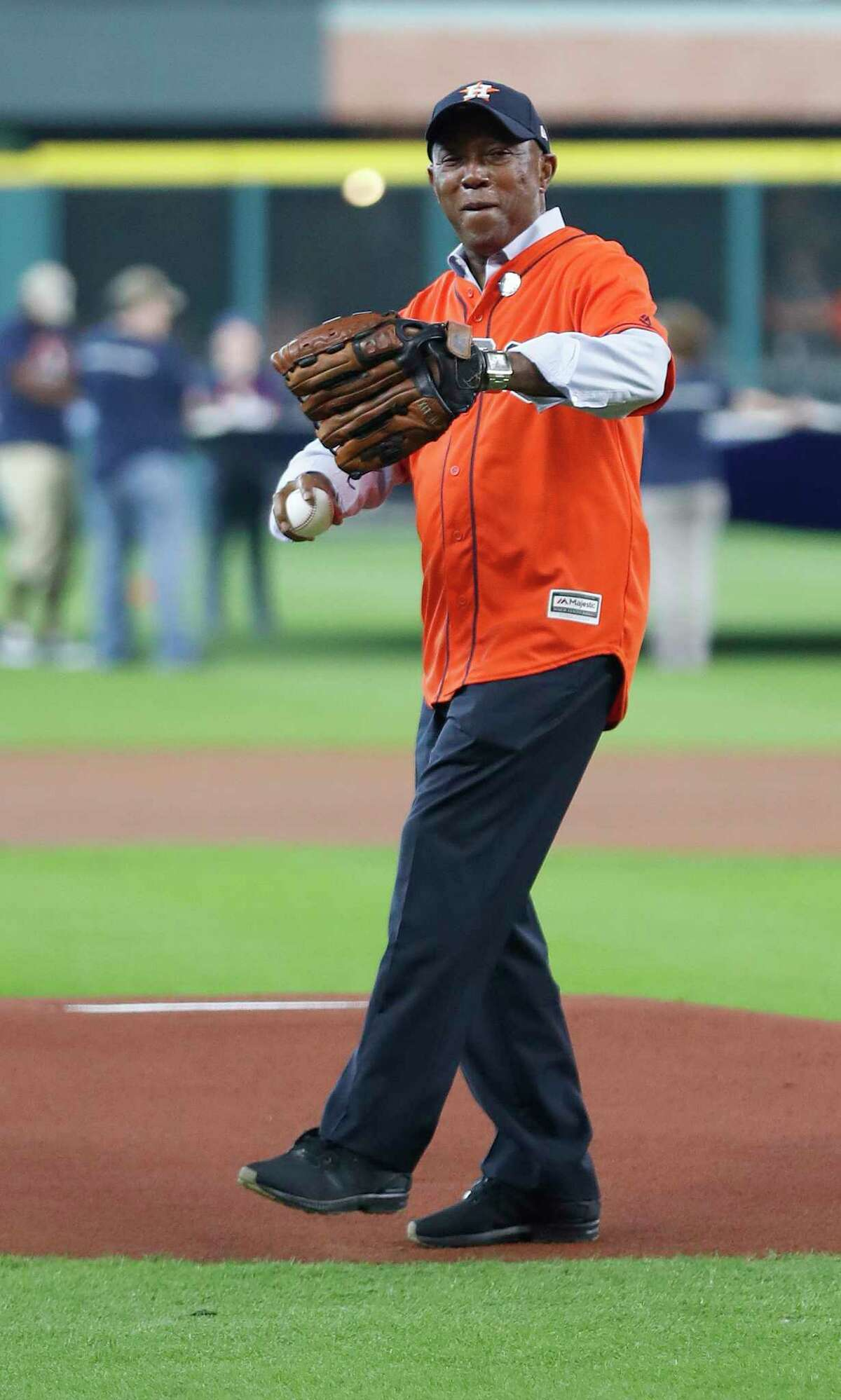 Houston Mayor Sylvester Turner throws out the first pitch before the start of an MLB baseball game at Minute Maid Park, Saturday, Sept. 2, 2017, in Houston. This is the first professional sporting event in the city since Tropical Storm Harvey.