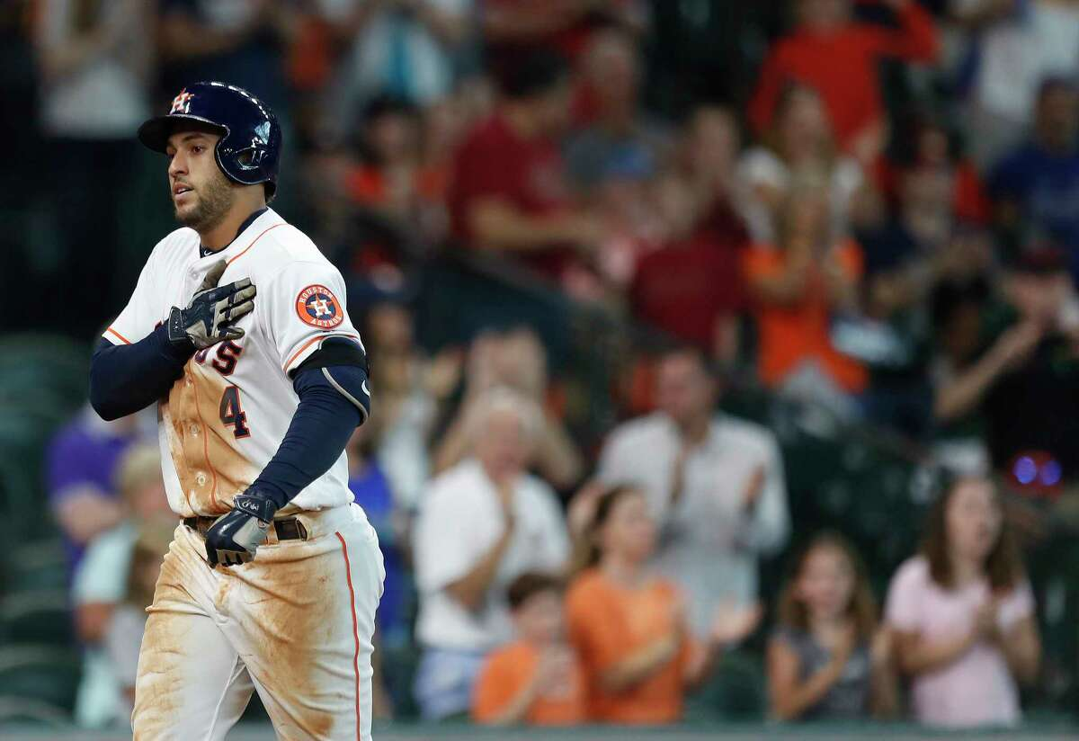 """George Springer pats the """"Houston Strong"""" patch on his jersey after hitting a two-run home run during the Astros' first game at Minute Maid Park after Hurricane Harvey on Sept. 2, 2017."""