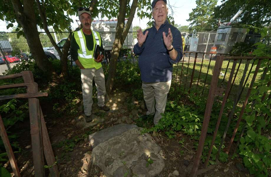 Norwalk Tree Advisory Chairman and The Care of Trees Arborist, Richard Whitehead, and Norwalk Tree Advisory Committee and Norwalk Tree Alliance member, Andrew Strauss, point out the stone monument that marked the second-largest oak tree in the U.S. back in 1951 Saturday, Aug. 26, on Martin Luther King Drive in Norwalk. The Norwalk Tree Alliance stumbled upon the stone monument dedicated by the Daughters of the American Revolution in 1951 to what was purported to be the second-largest oak tree in the United States at the time. The tree is long gone, but the Tree Alliance, Norwalk Tree Advisory Commission and Daughters of the American Revolution plan to rededicate the stone monument this fall. Photo: Erik Trautmann / Hearst Connecticut Media / Norwalk Hour