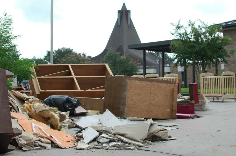 Soiled debris sits in the parking lot at Dickinson First United Methodist Church following Hurricane Harvey Saturday, Sep. 2. Photo: Kirk Sides, Houston Chronicle / © 2017 Kirk Sides / Houston Chronicle