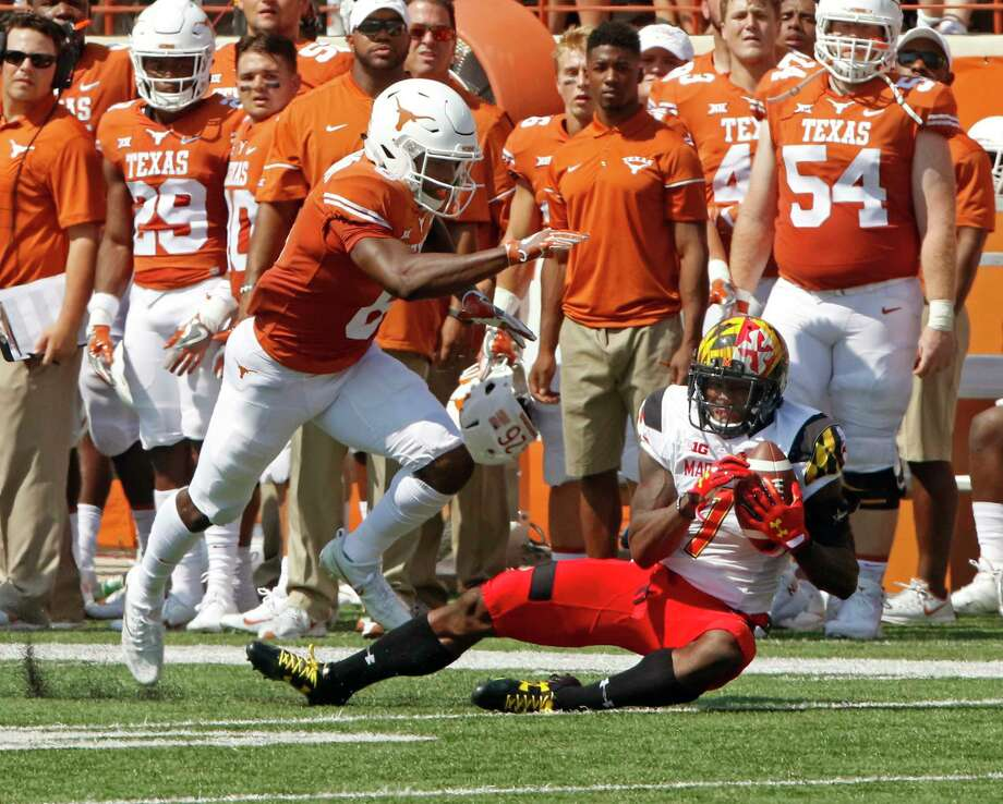 Maryland defensive back JC Jackson right, intercepts Texas quarterback Shane Buechele's pass intended for Dorian Leonard, left, during the first half of an NCAA college football game, Saturday, Sept. 2, 2017, in Austin, Texas. (AP Photo/Michael Thomas) Photo: Michael Thomas, FRE / FR65778 AP