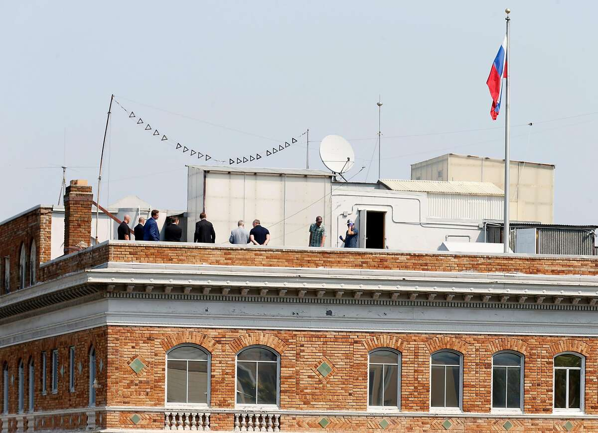 A group of men gather on the roof of the Russian Consulate in San Francisco, Calif. on Saturday, Sept. 2, 2017 on the day it was ordered to shut down operations by the Trump Administration.