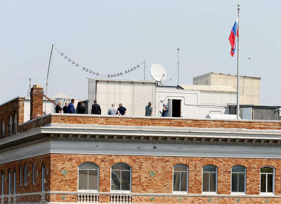 A group of men gather on the roof of the Russian Consulate in San Francisco, Calif. on Saturday, Sept. 2, 2017 on the day it was ordered to shut down operations by the Trump Administration. Photo: Paul Chinn / The Chronicle