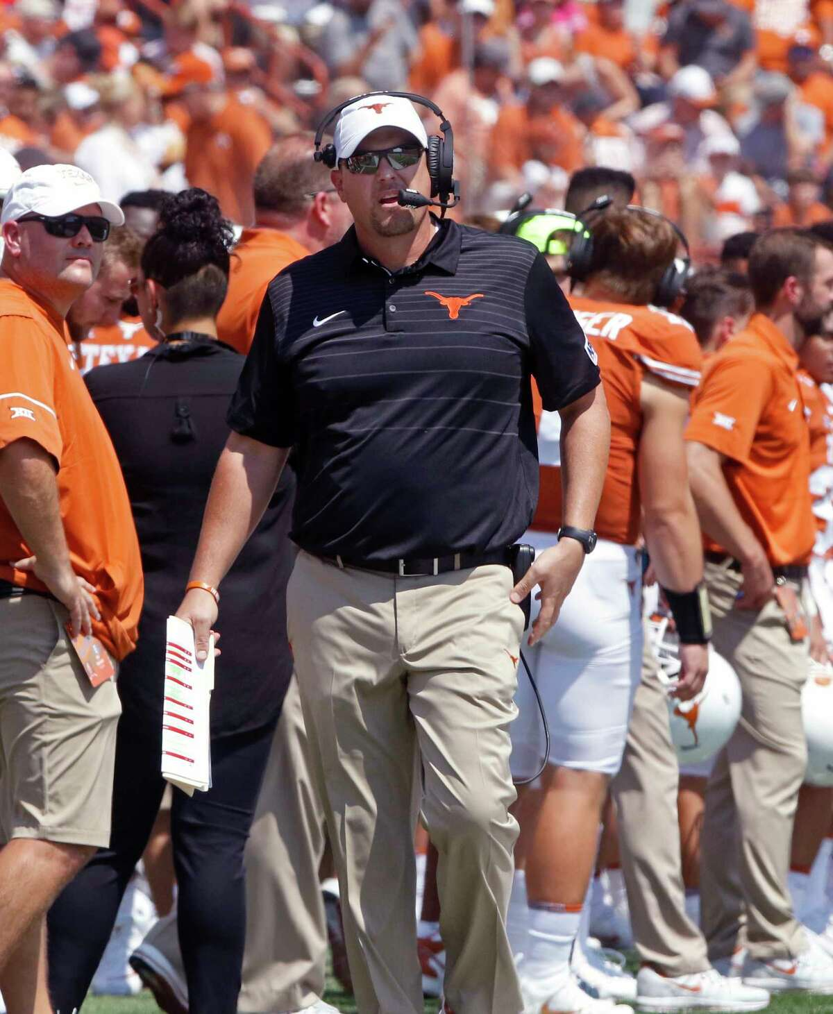 Texas head coach Tom Herman, center, looks at the scoreboard during the first half of an NCAA college football game against Maryland, Saturday, Sept. 2, 2017, in Austin, Texas. Maryland won 51-41. (AP Photo/Michael Thomas)